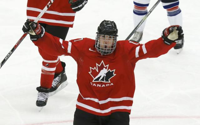 Canada's Connor McDavid (17) celebrates his goal against the United State during the third period of their IIHF World Junior Championship ice hockey game in Malmo, Sweden, December 31, 2013. REUTERS/Alexander Demianchuk (SWEDEN - Tags: SPORT ICE HOCKEY)