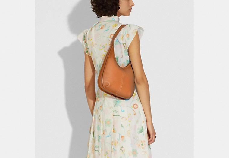 <p>If you love hobo-inspired shoulder bags, then treat yourself to the <span>Coach Ergo Shoulder Bag</span> ($395). It also comes in black and an ivory shade.</p>