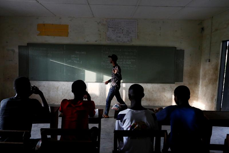 Boys take extra lessons after school hours in Obuasi, Ghana.(Photo: Francis Kokoroko/Reuters)