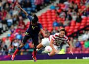 Abby Wambach (R) of USA clashes with Kelis Peduzine of Columbia during the Women's Football first round Group G match between United States and Colombia on Day 1 of the London 2012 Olympic Games at Hampden Park on July 28, 2012 in Glasgow, Scotland. (Photo by Stanley Chou/Getty Images)