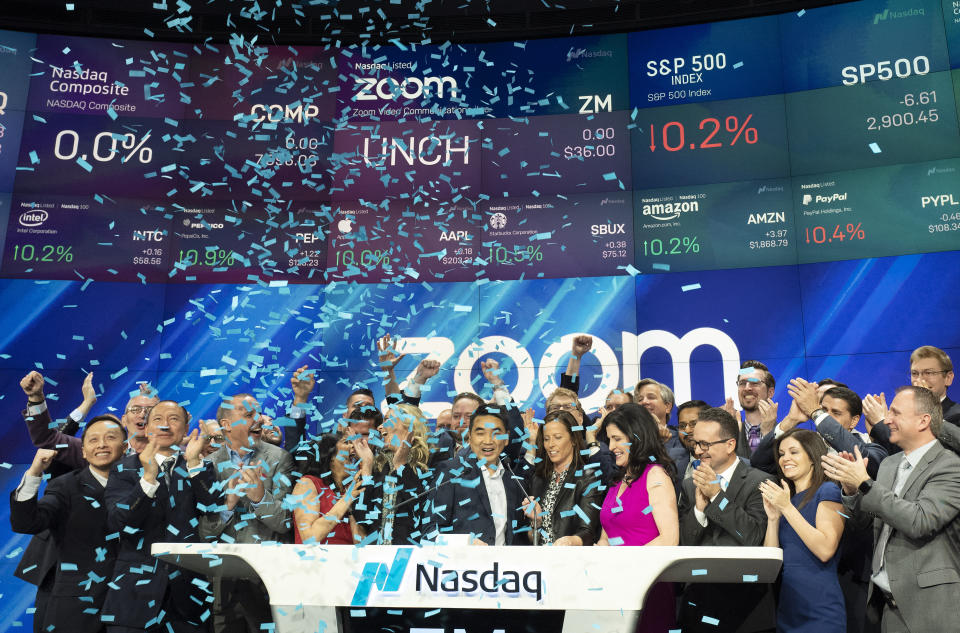 Employees and guests of Zoom celebrate at Nasdaq as the company holds its IPO, Thursday, April 18, 2019, in New York. The videoconferencing company is headquartered in San Jose, Calif. (AP Photo/Mark Lennihan)