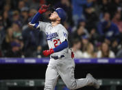 Los Angeles Dodgers' Alex Verdugo gestures as he crosses home plate after hitting a solo home run off Colorado Rockies starting pitcher Jon Gray in the seventh inning of a baseball game Saturday, April 6, 2019, in Denver. (AP Photo/David Zalubowski)