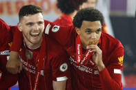 Liverpool fullbacks (from left) Andrew Robertson and Trent Alexander-Arnold celebrate winning the Premier League. (PHOTO: Phil Noble/Pool via Getty Images)