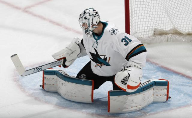 San Jose Sharks goaltender Martin Jones deflects a Colorado Avalanche shot during the first period of Game 4 of an NHL hockey second-round playoff series Thursday, May 2, 2019, in Denver. (AP Photo/David Zalubowski)