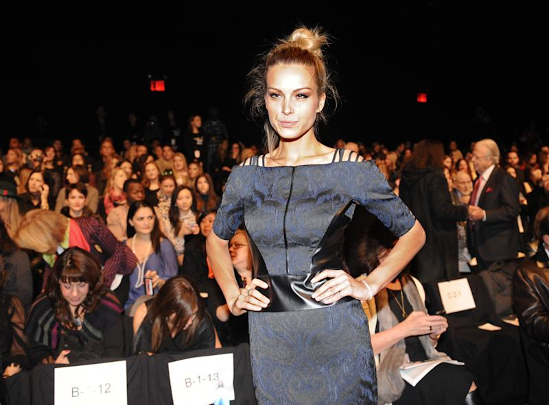 Model Petra Nemcova arrives for the showing of the Badgley Mischka Fall 2013 collection during Fashion Week, Tuesday, Feb. 12, 2013, in New York. (AP Photo/Louis Lanzano)