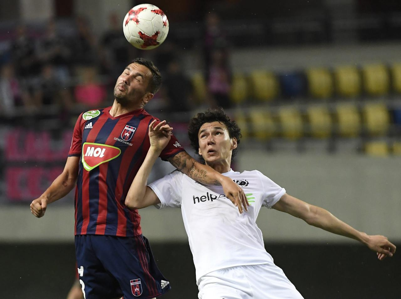 Anel Hadzic of Videoton, left, in action with Artur Valikaev of Nomme Kalju during the UEFA Champions League second qualifying round second leg match of FC Videoton of Hungary and FC Nomme Kalju of Estonia in Pancho Arena in Felcsut, 42 kms southwest of Budapest, Hungary, Thursday, July 20, 2017. (Tamas Kovacs/MTI via AP)