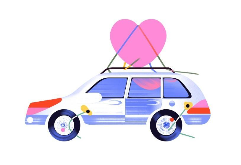 A car heading home with a huge heart strapped to the roof.