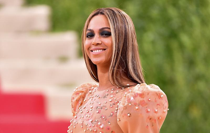 Beyoncé and Blue Ivy Channeled Wakanda in Metallic Gold Gowns and Looked Incredible