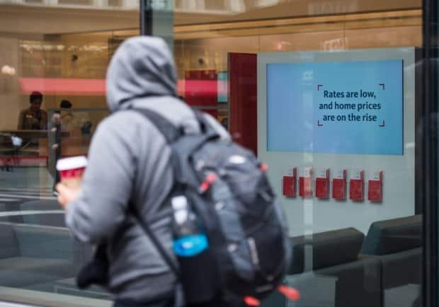 Canada's top banking regulator is raising the mortgage stress test level to 5.25 per cent or two percentage points above the market rate, whichever is higher. (Ron Antonelli/Bloomberg - image credit)