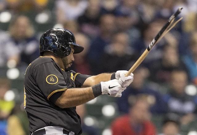 Pittsburgh Pirates' Pedro Alvarez grounds out with a broken bat against the Milwaukee Brewers during the first inning of a baseball game on Friday, April 11, 2014, in Milwaukee. (AP Photo/Tom Lynn)
