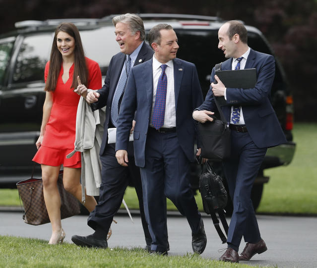 White House adviser Hope Hicks (L-R), Chief White House Strategist Steve Bannon, White House Chief of Staff Reince Priebus and senior adviser Stephen Miller, walk across the South Lawn of the White House in Washington, Saturday, April 29, 2017, to board Marine One helicopter and join President Donald Trump for the short flight to Andrews Air Force Base, Md., before traveling to Harrisburg, PA., for a rally. (AP Photo/Pablo Martinez Monsivais)
