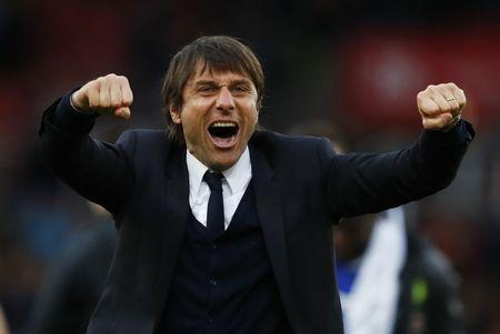 Chelsea manager Antonio Conte celebrates after the game