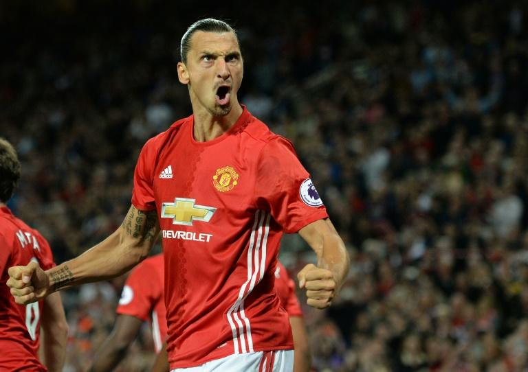 Manchester United's Swedish striker Zlatan Ibrahimovic celebrates after scoring their second goal from the penalty spot during the English Premier League football match against Southampton on August 19, 2016