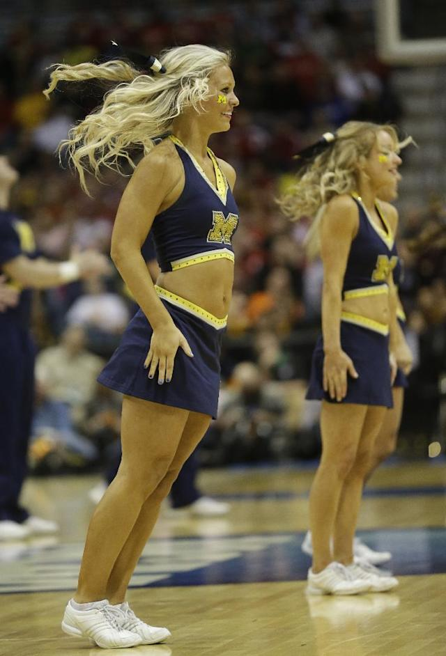 Michigan cheerleaders perform during the second half of a second round NCAA college basketball tournament game between the Michigan and the Wofford Thursday, March 20, 2014, in Milwaukee. (AP Photo/Morry Gash)