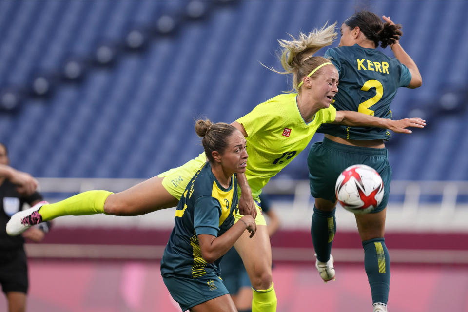 Sweden's Amanda Ilestedt (13) goes for a header during a women's soccer match against Australia at the 2020 Summer Olympics, Saturday, July 24, 2021, in Saitama, Japan. (AP Photo/Martin Mejia)
