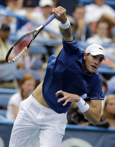 John Isner serves during his match against Dmitry Tursunov, from Russia, at the Citi Open tennis tournament, Saturday, Aug. 3, 2013, in Washington. (AP Photo/Alex Brandon)