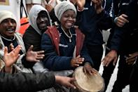 Migrants headed for Sicily play music aboard a rescue vessel -- but even as a harder line on asylum has seen arrivals slump since mid-2016 Italy's incoming populist-hard right government wants to tighten procedures further (AFP Photo/LOUISA GOULIAMAKI)