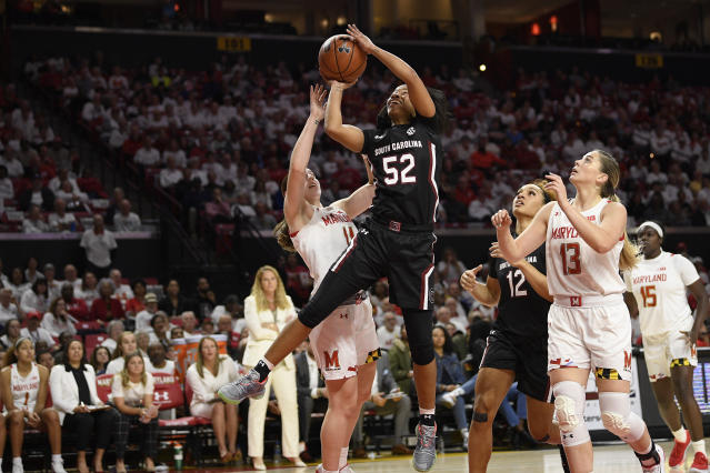 South Carolina guard Tyasha Harris (52) goes to the basket against Maryland guard Taylor Mikesell, left, during the first half of an NCAA college basketball game, Sunday, Nov. 10, 2019, in College Park, Md.Maryland forward Faith Masonius (13) and guard Ashley Owusu (15) and South Carolina guard Brea Beal (12) watch. (AP Photo/Nick Wass)