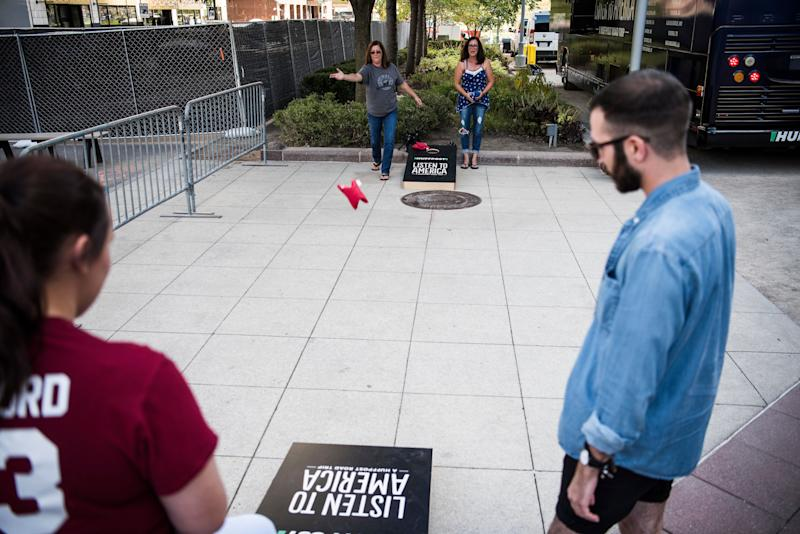 Wendy Agbay, Christy Barford, Thomas Gregovich and Sarah Barford play a game of cornhole.