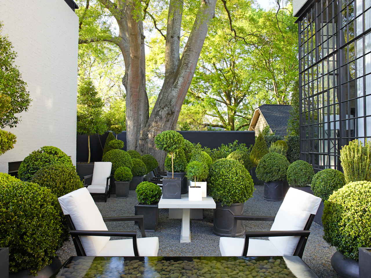 "<p>Nothing freshens up the facade of a house like emerald-green shrubbery. Thanks to their versatility, boxwoods are a perennial favorite among traditionalists and modernists alike. Long associated with <a href=""https://www.veranda.com/outdoor-garden/g1134/beautiful-french-gardens/"" target=""_blank"">French gardens</a> with clipped hedges demarcating shapely parterres, the small-leafed bush is an obvious choice for adding formality to any house facade. Yet its sculptural nature also lends itself quite nicely to minimalist settings. </p><p>Beyond just their style, boxwoods serve many functions in landscaping, from framing an entry and <a href=""https://www.veranda.com/outdoor-garden/g30914247/best-edging-plants/"" target=""_blank"">edging a walkway border</a> to surrounding an <a href=""https://www.veranda.com/outdoor-garden/g27405184/best-outdoor-fountains/"" target=""_blank"">outdoor fountain</a> to marking off a <a href=""https://www.veranda.com/outdoor-garden/g30696429/plants-for-shade/"" target=""_blank"">shady flower bed</a>. And, they require less maintenance than you might think: although they require watering and mulching, boxwoods do require regular tending, unless you opt for a super-sheared look. </p><p>Whether you're craving something formal or a little more low maintenance, let these beautiful boxwood landscape ideas inspire your next weekend project. Happy planting! </p>"