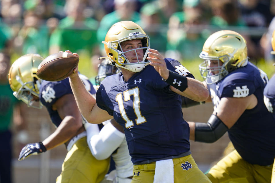 Notre Dame quarterback Jack Coan (17) throws against Purdue during the first half of an NCAA college football game in South Bend, Ind., Saturday, Sept. 18, 2021. (AP Photo/Michael Conroy)