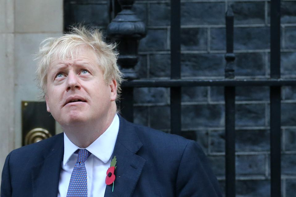 Britain's Prime Minister Boris Johnson looks up as he meets with fundraisers for the Royal British Legion outside 10 Downing street in central London on October 28, 2019. - European Union members agreed today to postpone Brexit for up to three months, stepping in with their decision less than 90 hours before Britain was due to crash out with no divorce deal. (Photo by ISABEL INFANTES / AFP) (Photo by ISABEL INFANTES/AFP via Getty Images)