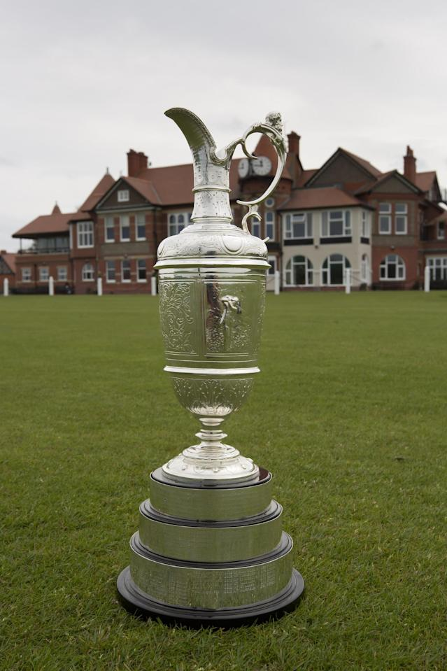 """The British Open Golf trophy the """"Claret Jug"""" is displayed by the clubhouse at the Royal Liverpool Golf Club before the British Open golf championships, Hoylake, England, Wednesday, April 23, 2014. The tournament begins on Thursday July 17, 2014. (AP Photo/Jon Super)"""