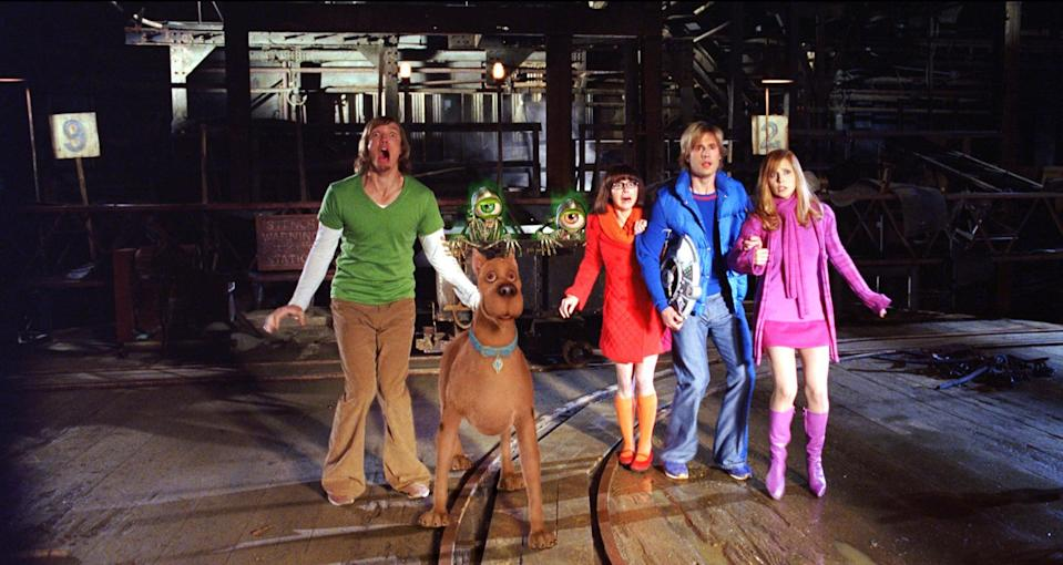 """<p><strong>HBO Max's Description:</strong> """"Scooby-Doo once again joins his pals Shaggy, Velma, Fred and Daphne as they stumble into another seemingly supernatural mystery. In addition to facing off against various monsters that are tormenting their town, the gang must deal with television journalist Heather Jasper-Howe, who is out to discredit their investigations.""""</p> <p><a href=""""https://play.hbomax.com/feature/urn:hbo:feature:GXdu2ZAZfFMPCwwEAADXD"""" class=""""link rapid-noclick-resp"""" rel=""""nofollow noopener"""" target=""""_blank"""" data-ylk=""""slk:Watch Scooby-Doo 2: Monsters Unleashed on HBO Max here!"""">Watch <strong>Scooby-Doo 2: Monsters Unleashed</strong> on HBO Max here!</a></p>"""