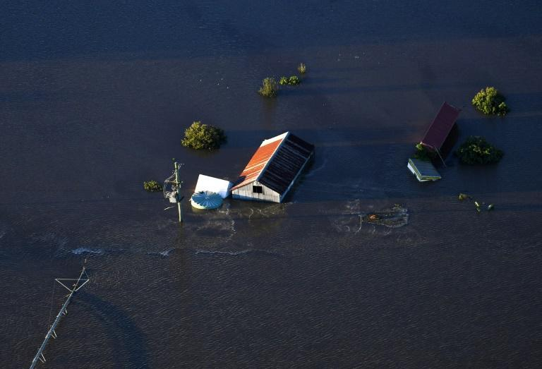 """Relentless downpours over the past week have caused """"catastrophic"""" flooding in Australia's most populous state, New South Wales, with parts of suburban northwest Sydney still under water"""