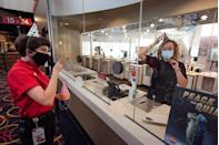 <p>Employees Devan Daugette and Bella Torres joke around with the party hats at the AMC Highlands Ranch 24 on August 20 in Highlands Ranch, Colorado.</p>