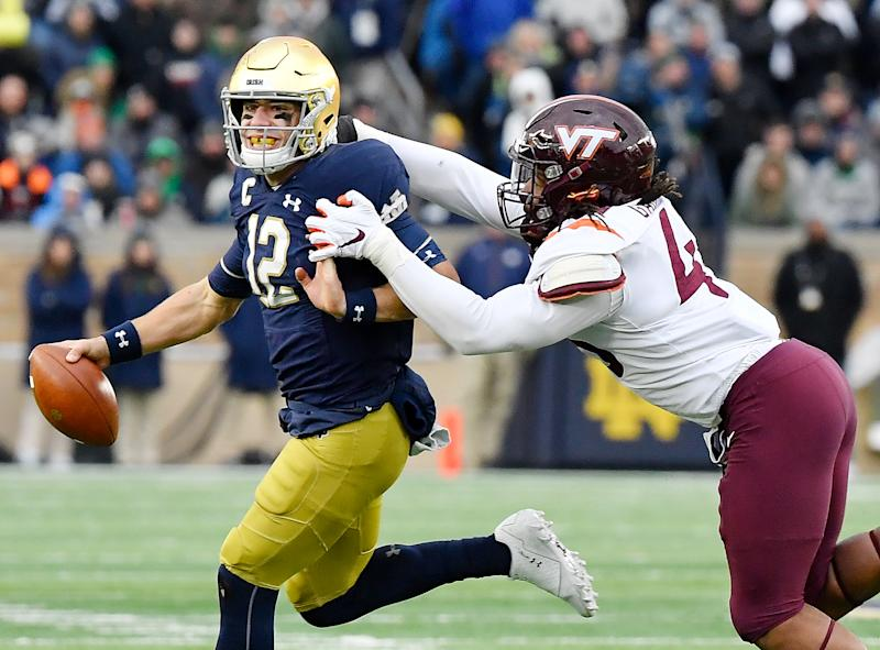 Notre Dame QB Ian Book led the game-winning drive vs. Virginia Tech but also struggled at times. (Getty Images)