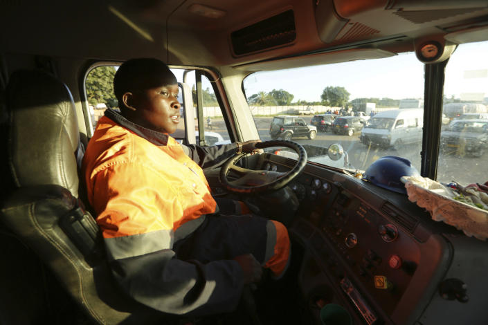 Molly Manatse a female truck driver is seen on the road in Harare, in this Saturday, March, 6, 2021 photo. There are very few female truck drivers in Zimbabwe, but Manatse doesn't like to be singled out for her gender. From driving trucks and fixing cars to encouraging girls living with disability to find their places in society, women in Zimbabwe are refusing to be defined by their gender or circumstances, even as the pandemic hits them hardest and imposes extra burdens.(AP Photo/Tsvangirayi Mukwazhi)