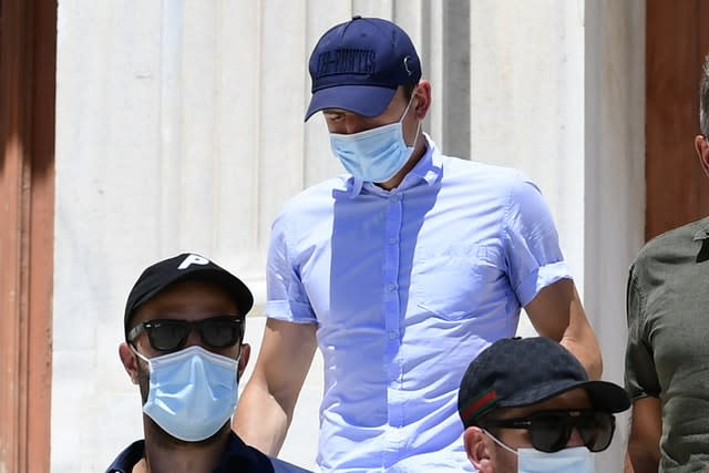 Harry Maguire, centre, leaves a court building on the island of Syros, Greece, on Saturday