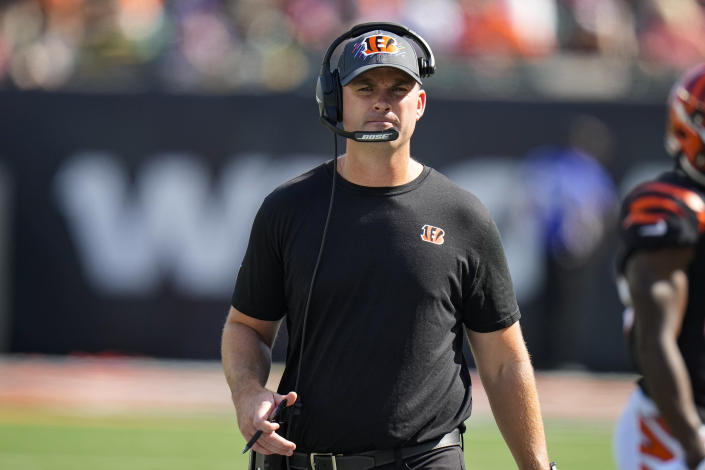 Cincinnati Bengals head coach Zac Taylor paces the sideline in the first half of an NFL football game against the Green Bay Packers in Cincinnati, Sunday, Oct. 10, 2021. (AP Photo/AJ Mast)