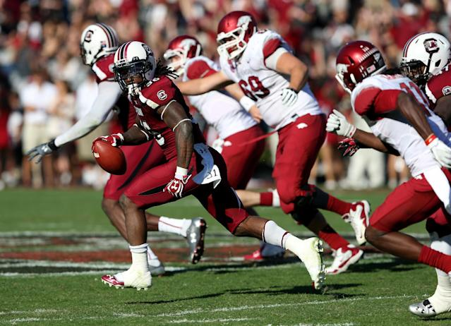 COLUMBIA, SC - NOVEMBER 10: D.J. Swearinger #36 of the South Carolina Gamecocks runs for a touchdown after making an interception against the Arkansas Razorbacks during their game at Williams-Brice Stadium on November 10, 2012 in Columbia, South Carolina. (Photo by Streeter Lecka/Getty Images)