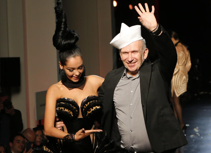 French fashion designer Jean-Paul Gaultier gestures with French TV reality star Nabilla after the presentation of his Haute Couture Fall-Winter 2013-2014 collection, Wednesday, July 3, 2013 in Paris. (AP Photo/Jacques Brinon)