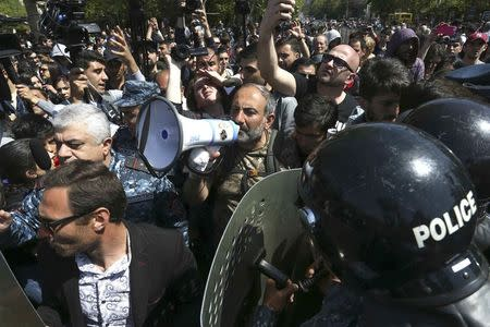 Armenian opposition MP Nikol Pashinyan uses a megaphone as he delivers a speech during a protest after parliament voted to allow former President Serzh Sarksyan to become Prime Minister in Yerevan, Armenia April 18, 2018. REUTERS/Vahram Baghdasaryan/Photolure  NO RESALES. NO ARCHIVES.