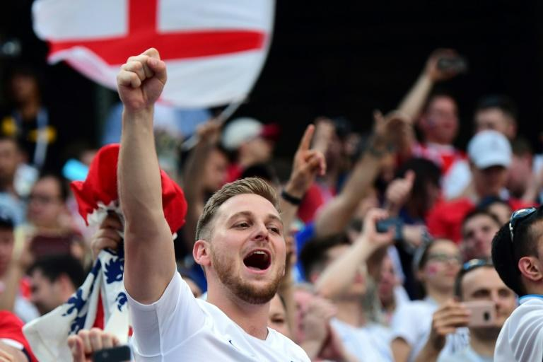 England football fans celebrate at the end of their 6-1 2018 World Cup Group G victory over Panama at the Nizhny Novgorod Stadium in Nizhny Novgorod, Russia on June 24, 2018