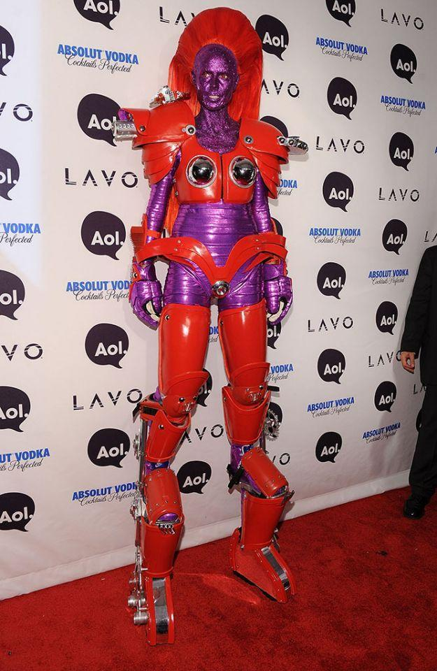 <p>No. 12: In 2010, standing out was not a problem. The<em> America's Got Talent judge</em> dressed as a Transformer with special boots, which boosted her height to 8 feet. Her costume included a purple glitter mask, colored contacts, and cool zigzag choppers. (Photo by Bryan Bedder/Getty Images) </p>