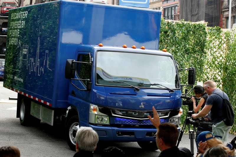 FILE PHOTO: A new Daimler AG, FUSO battery-powered eCanter urban delivery truck is unveiled during a news conference in New York