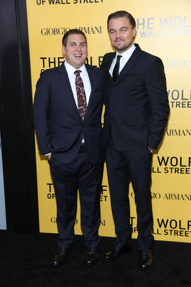 """NEW YORK, NY - DECEMBER 17: Leonardo DiCaprio (R) and Jonah Hill attend the """"The Wolf Of Wall Street"""" premiere at Ziegfeld Theater on December 17, 2013 in New York City. (Photo by Rob Kim/Getty Images)"""