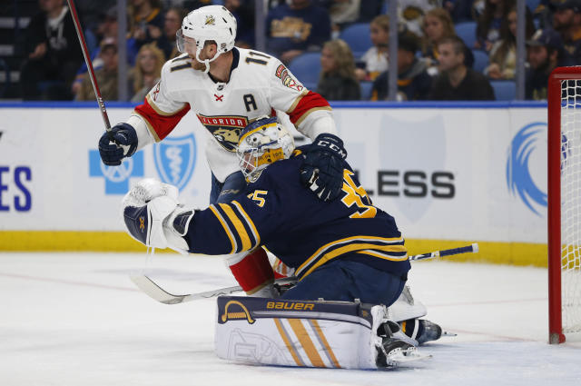 Buffalo Sabres goalie Linus Ullmark (35) and Florida Panthers forward Jonathan Huberdeau (11) collide during the second period of an NHL hockey game, Friday, Oct. 11, 2019, in Buffalo, N.Y. (AP Photo/Jeffrey T. Barnes)