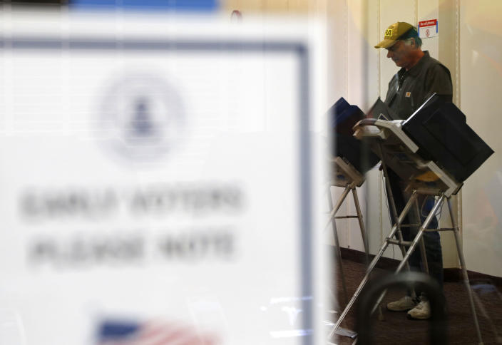 """Randy Wick, age 68, fills his midterm election ballot at an early voting poll at a mall in Bloomingdale, Ill., on Thursday, Oct. 25, 2018. Wick, a member of the NRA who """"leans"""" Republican and conservative and lives in Roselle, Illinois, says that despite the country's polarization, he still has hope people can come together. """"We've got a lot of good in us,"""" he said. """"I wish it could be that way all the time. I think there are more good people than bad."""" (AP Photo/Martha Irvine)"""