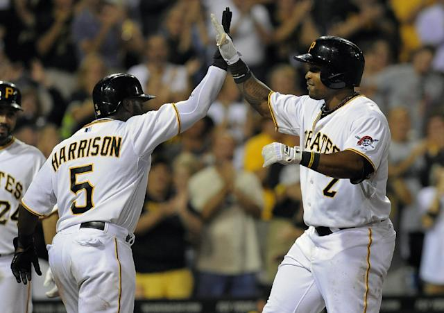 Pittsburgh Pirates' Josh Harrison (5) and Marlon Byrd, right, celebrate at home plate after Byrd hit a three-run home run during the seventh inning of a baseball game against the Milwaukee Brewers, Wednesday, Aug. 28, 2013, in Pittsburgh. Pittsburgh won 7-1. (AP Photo/Don Wright)