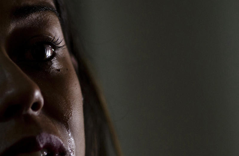 """In this Thursday, March 30, 2017 photo, Juliana Oliveira, a former member of the Word of Faith Fellowship, cries during an interview in Betim, Brazil. """"When you are in a cult, you don't know you are in a cult because little by little it all becomes 'normal,'"""" said Oliveira. """"It's like a frog in a pot of water. By the time it's boiling, he can't jump out."""" (AP Photo/Silvia Izquierdo)"""