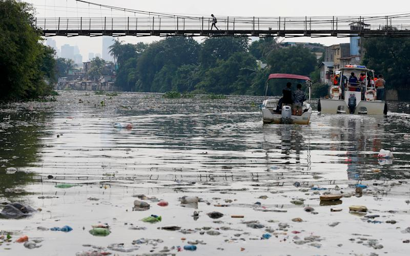 The Government's Pasig River Rehabilitation Commission and environmentalists from Greenpeace survey the polluted Pasig River to track plastic waste to draw attention to the hazards of plastics and waste which clog rivers and tributaries, Friday, Sept. 8, 2017, in San Juan city, east of Manila, Philippines. In a statement the environmental group urges ASEAN governments to stiffen policies on waste management and to arrest the rising rate of waste being dumped into the ocean and finding their way to the open seas. (AP Photo/Bullit Marquez)
