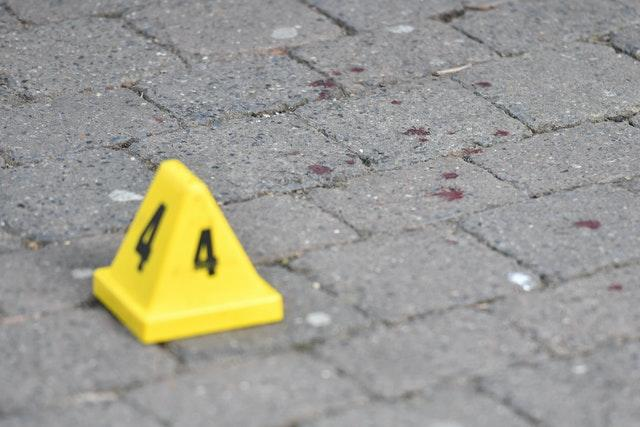 Police marker indicating possible specks of blood on Hurst Walk (Jacob King/PA)