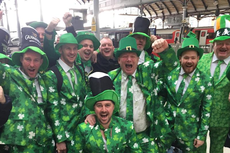 #Shamrockgate: but at least this group celebrating St Patrick's Day are wearing the correct three-leaved clover on their suits: PA