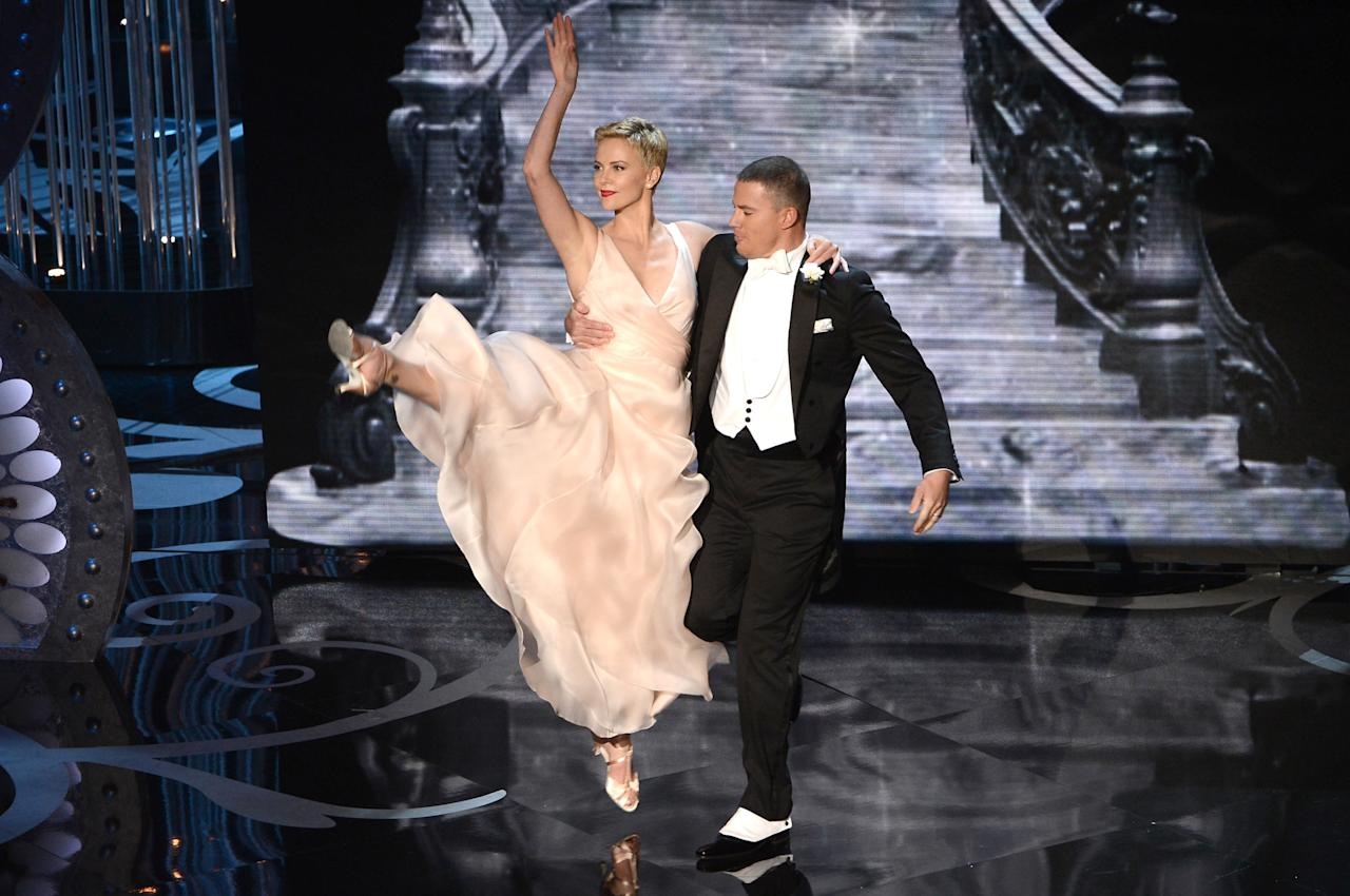 HOLLYWOOD, CA - FEBRUARY 24:  Actress Charlize Theron and actor Channing Tatum dance onstage during the Oscars held at the Dolby Theatre on February 24, 2013 in Hollywood, California.  (Photo by Kevin Winter/Getty Images)