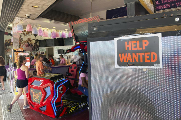 A Help Wanted sign hangs at an arcade on the boardwalk in Ocean City, New Jersey, on Thursday, July 22, 2021. (AP Photo/Ted Shaffrey).